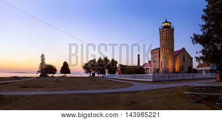 The Old Mackinac Point Lighthouse and the Straits of Mackinac In early morning just before sunrise Michigan Lower Peninsula USA The light is never actually lit - Photoshop Simulation