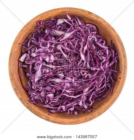 Shredded red cabbage in a bowl. Top view.