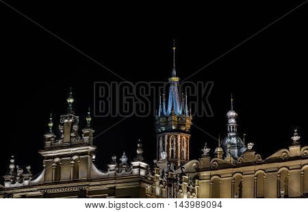 details on main square of cracow at night
