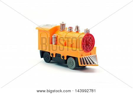 Yellow plastic train toy on white background side view
