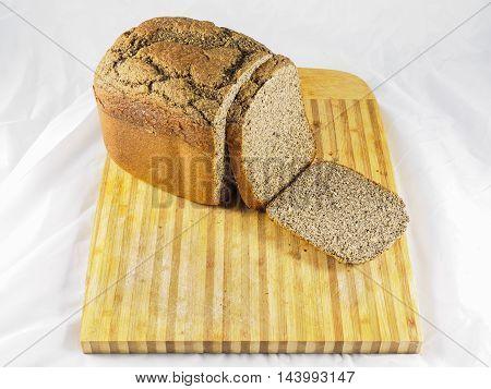 Loaf of self-made gluten-free bread on cutting board