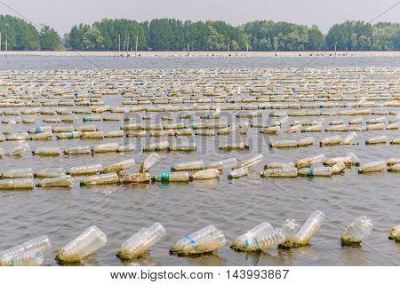 Shellfish Farm From Old Plastic Bottles In Sea At Chanthaburi, Thailand