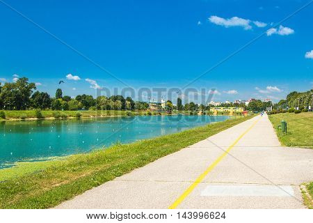 Jarun lake in Zagreb, Croatia, sunny summer day, and recreation pathway