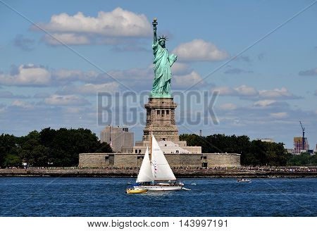 New York City - August 27 2015: The Statue of Liberty by French sculptor Frederic-Auguste Bartholdi on Bedloe's Island at the entry to NY harbour