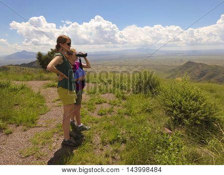 SIERRA VISTA, ARIZONA, AUGUST 21. Coronado Peak on August 21, 2016, near Sierra Vista, Arizona. A mother and daughter take in the view on top of Coronado Peak in the Huachuca Mountains near Sierra Vista Arizona.
