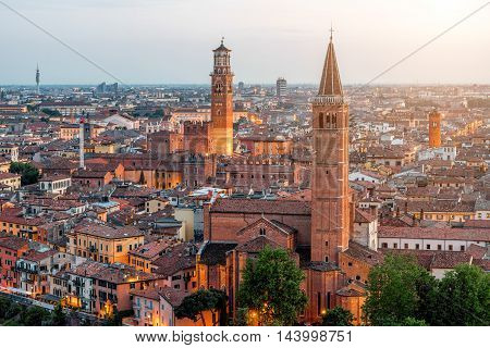 Verona aerial view on illuminated old town on the sunset in Italy