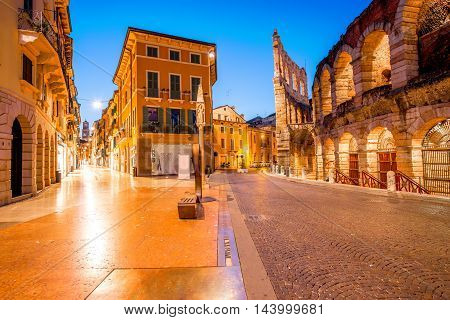 Night view on illuminated Bra square with Arena in Verona city