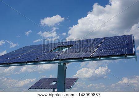 single solar panel in solar power station under storm cloud