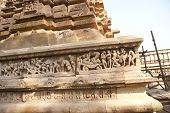 pic of kama  - Sculptures of loving couples illustrating the Kama Sutra on walls of Lakshmana Temple at Khajuraho in India Asia - JPG