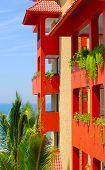foto of hacienda  - Traditional hacienda style building painted in orange with the ocean in background - JPG