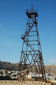Old Oil Derrick During Bright Summer Day poster