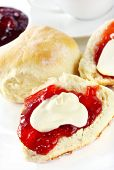 Fresh scones with strawberry jam and fresh cream, served with a cup of tea.  Known as a Devonshire t