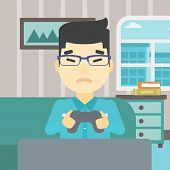 An asian aggressive gamer playing video game on the television and losing. An angry young man with c poster