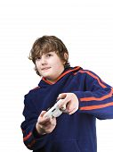 stock photo of video game controller  - Young boy playing a video game with his tongue out - JPG