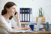 Young Business Woman On Phone poster