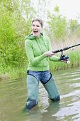 foto of fisherwomen  - woman fishing in pond in spring country - JPG