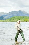 image of fisherwomen  - fishing woman in Loch Venachar Trossachs Scotland - JPG