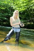 picture of fisherwomen  - woman fishing in river in summer country - JPG