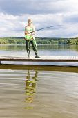 picture of fisherwomen  - fishing woman standing on pier in summer country - JPG
