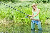 pic of fisherwomen  - woman fishing in pond in green spring country - JPG