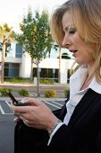 Business Woman Sending Message On Blackberry