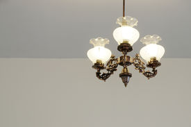 stock photo of light fixture  - Decorative ceiling light with bare walls and copy space - JPG
