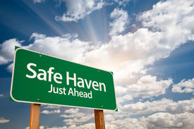 stock photo of safe haven  - Safe Haven Green Road Sign with Dramatic Clouds - JPG