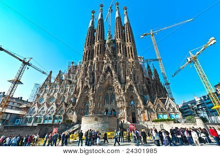 Tourists looking Sagrada Familia