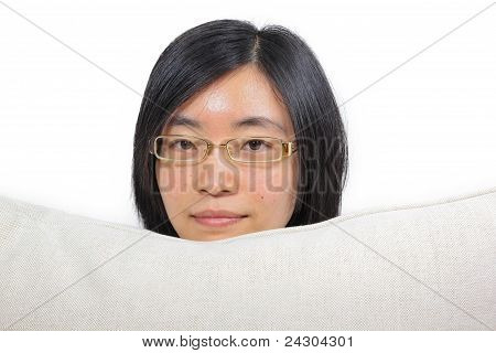 Young Chinese Woman Hugging A Pillow