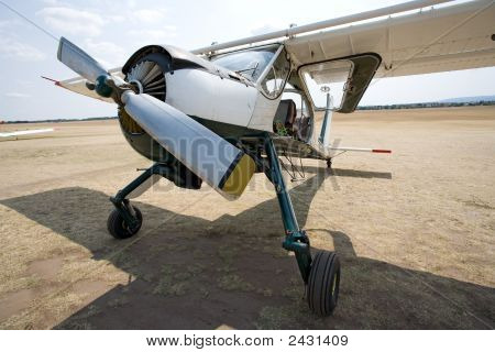 Old Aircraft On The Ground, Front View, Wide Perspective