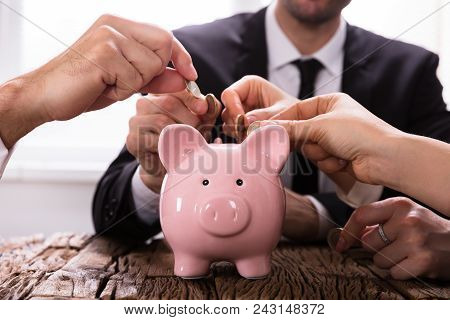 poster of Crowdfunding Concept. People Inserting Coins Into Piggybank