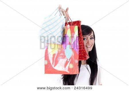 Smiling Woman Hiding Behind Her Shopping Bags