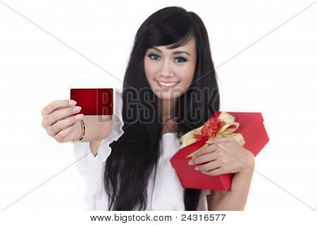 Woman With Christmas Present And A Blank Card