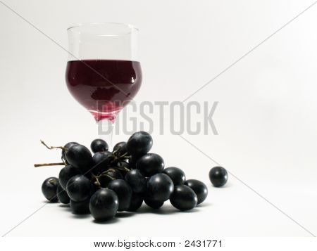 Bocal Of Red Wine And Brunch Of Grapes