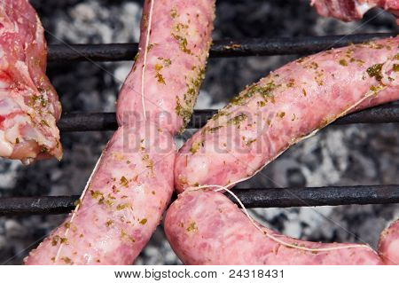 Several sausages cooked in a barbecue. Enjoy your meal