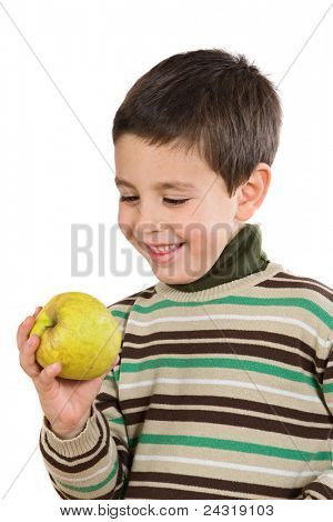 Adorable boy with a apple on a white background