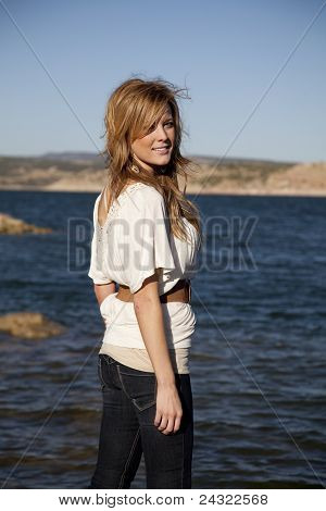 Woman Looking Back By Water