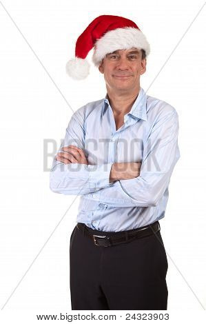 Handsome Smiling Business Man in Santa Christmas Hat and Arms Folded