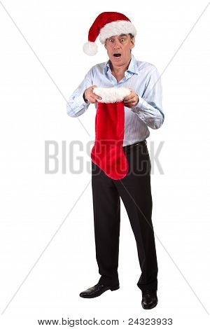 Business Man in Santa Hat shocked at contents of Christmas Stocking