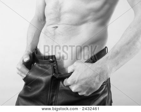 A well muscled man in leather pants