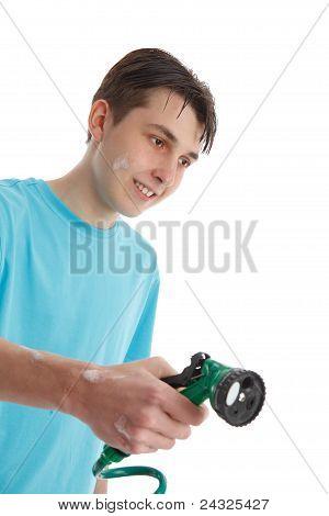 Boy Using A Garden Hose