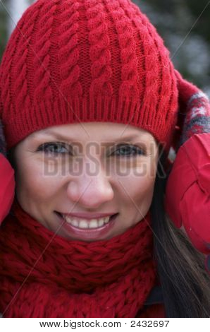 Young Beautiful Woman In A Red Cap