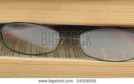 Eyeglasses On The Betwixt Pages Old Book.