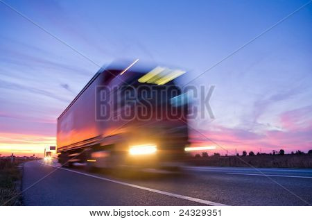 long exposure of truck at sunset