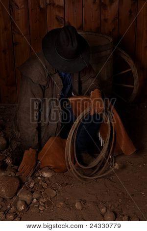 Cowboy Kneeling By Barrel Head Way Down