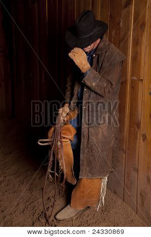 Cowboy Leaning On Wall