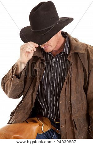 Cowboy Leaning Over Touching Hat