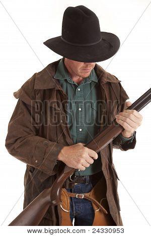 Cowboy Looking Down At Shotgun