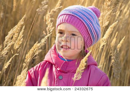 Portrait of a Girl in dry grass