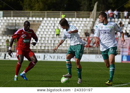 KAPOSVAR, HUNGARY - SEPTEMBER 24: Adamo Coulibaly (in red) in action at a Hungarian National Championship soccer game - Kaposvar (white) vs Debrecen (red) on September 24, 2011 in Kaposvar, Hungary.
